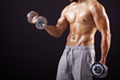 Fitness man lifting dumbbells on black background