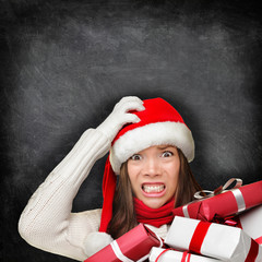 Christmas holiday stress - stressed gift woman