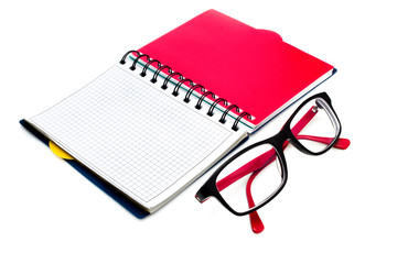 Glasses and notebook isolated on white