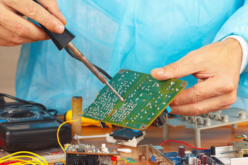 Soldering electronic board in the service workshop