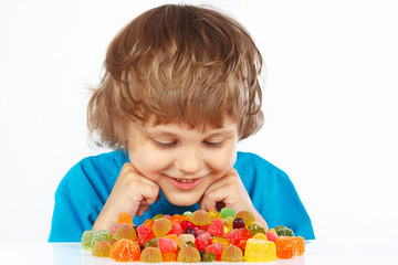 Child with jelly candies on a white background