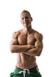Fit shirtless male model posing with confidence, arms crossed