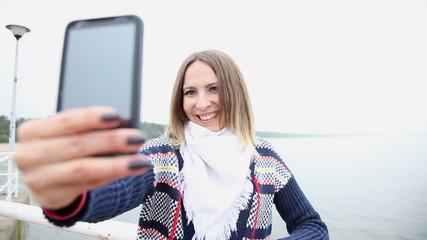Happy girl  taking photo of herself selfie