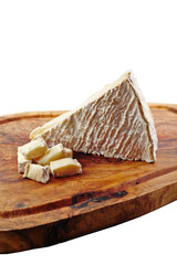 Soft cheese on wooden board and white background