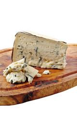 Cheese on wooden board and white background