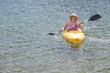 Woman Kayaking on Beautiful Mountain Lake.