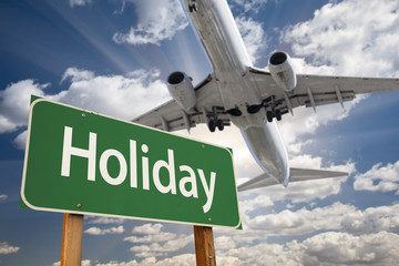 Holiday Green Road Sign and Airplane Above