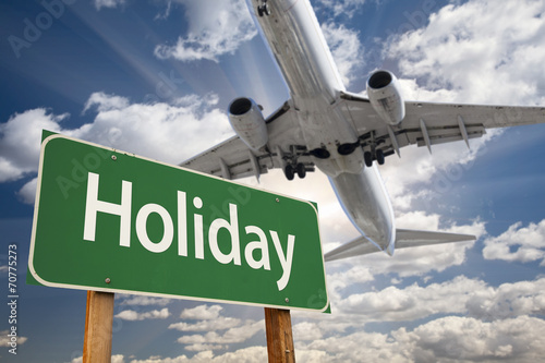 Foto op Canvas Texas Holiday Green Road Sign and Airplane Above