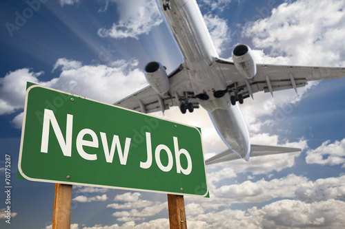 Foto op Canvas Texas New Job Green Road Sign and Airplane Above