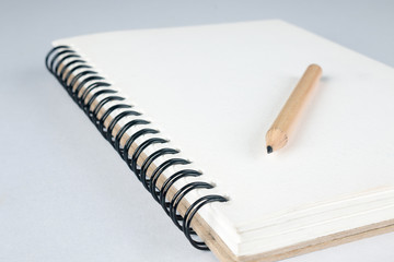sketch book with pencil