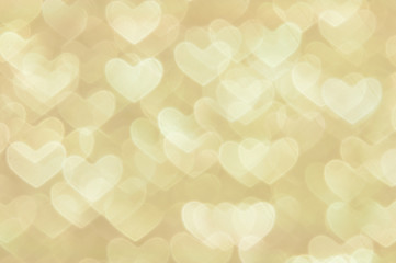 defocused abstract golden hearts light background