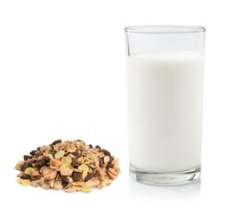 pile of muesli and fresh milk in the glass isolated on white bac