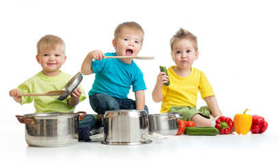 Kids group cooking isolated on white. Three boys are playing wit