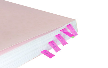 White book with colourful tags