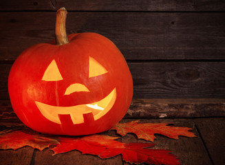 pumpkin head on wooden background with copy space
