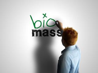 Bio mass. Boy writing on a white board