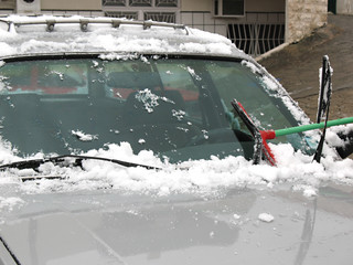 Brushing Snow Off of Windshield