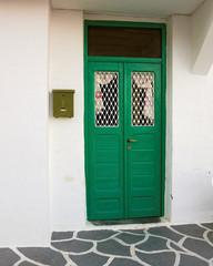 Greece Milos island, picturesque house green door