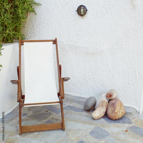 Papiers peints Detente Greece Milos island, deckchair in tranquil yard corner