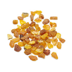 Pile of amber beads isolated on the white background
