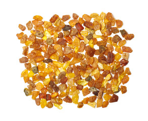 Variety of amber beads isolated on the white background