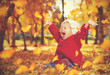 canvas print picture - happy little child, baby girl laughing and playing in autumn