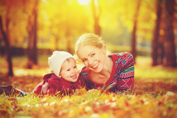 happy family: mother and child little daughter  in  autumn