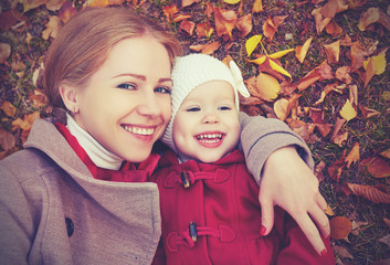 happy family: mother and child  daughter  cuddling  autumn