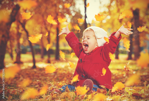 canvas print picture happy little child, baby girl laughing and playing in autumn