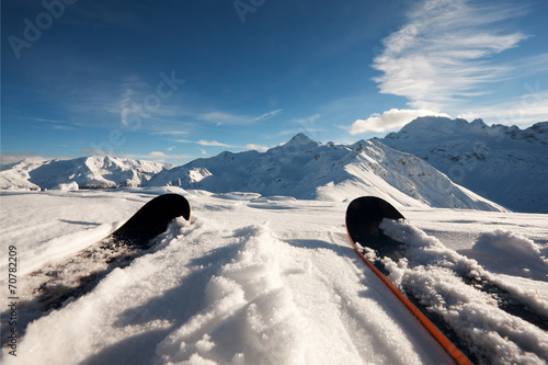 Skis in snow at Mountains - 70782209