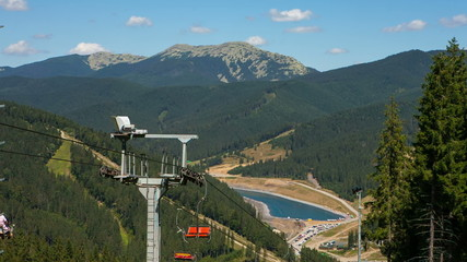 The chair lift in mountains summer
