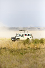 Safari tourists on game drive in Serengeti