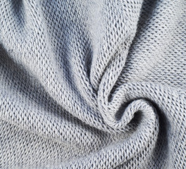 Fragment of a knitted gray cloth