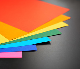 Colorful sheets over the black surface