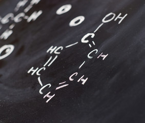Blackboard with some chemistry structures drawn