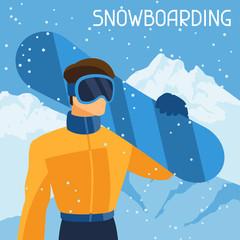 Man snowboarder on mountain winter landscape background.