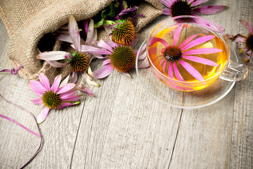Cup of echinacea  tea on wooden table