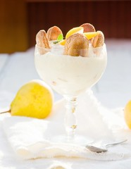 Dessert with pears, creamy cream and cookies