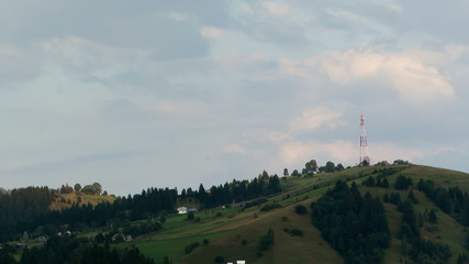 Time-lapse: Communications tower on mountain with blue sky