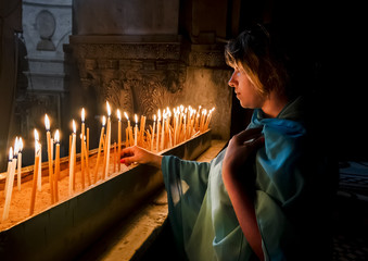 The pilgrims lit candles at the Church of the Holy Sepulchre in