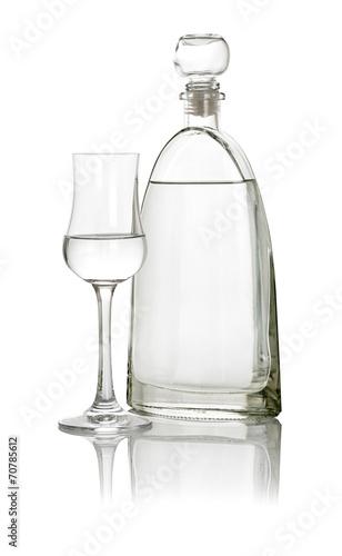 canvas print picture gefülltes Grappaglas mit Flasche