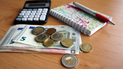 Pile of euro banknotes and office accessories