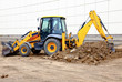 Yellow excavator working with a lot of soil - 70786095