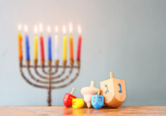 image of front woodwn table and menorah un the background. hanuk