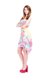 Beautiful young happy woman in light dress.