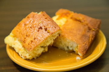 Two Pieces of Cornbread on Plate