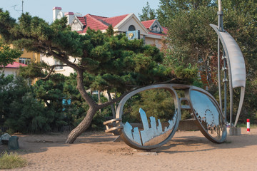 Sculpture of mirror points on a beach