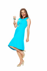 happy woman in blue dress posing against white