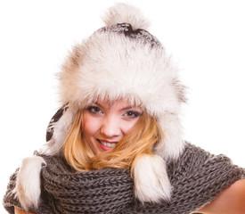 Winter fashion girl in fur hat doing fun isolated