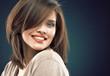 Woman beauty face against dark studio background.